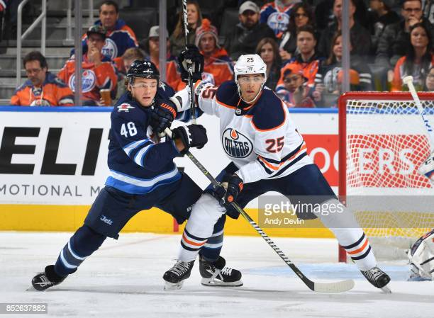 Darnell Nurse of the Edmonton Oilers battles for position against Brendan Lemieux of the Winnipeg Jets on September 23 2017 at Rogers Place in...