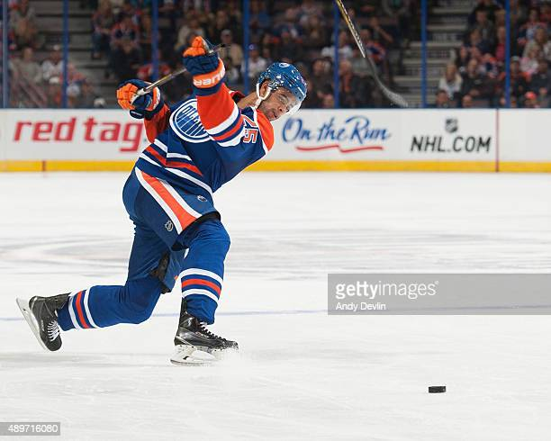 Darnell Nurse of the Edmonton Oilers breaks a stick while taking a shot during a preseason game against the Winnipeg Jets on September 23 2015 at...