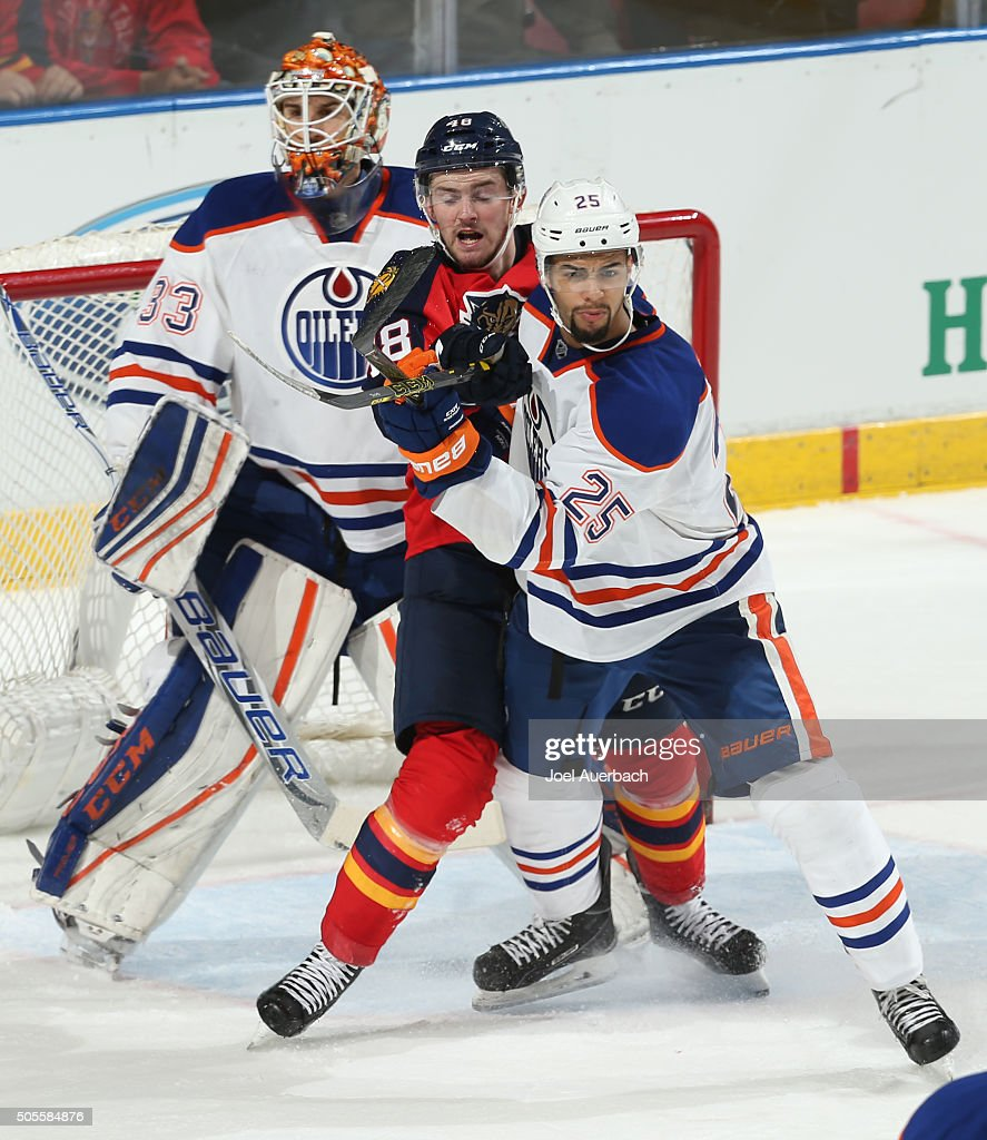 Darnell Nurse #25 of the Edmonton Oilers defends against Logan Shaw #48 of the Florida Panthers in front of goaltender Cam Talbot #33 during third period action at the BB&T Center on January 18, 2016 in Sunrise, Florida. The Oilers defeated the Panthers 4-2.