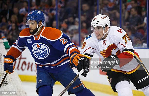 Darnell Nurse of the Edmonton Oilers defends against Micheal Ferland of the Calgary Flames on April 2 2016 at Rexall Place in Edmonton Alberta Canada