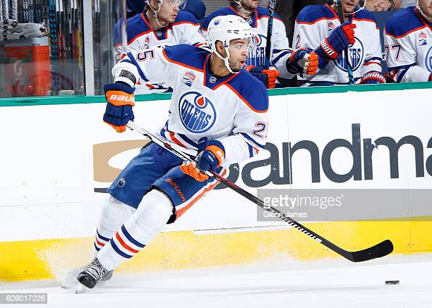 Darnell Nurse of the Edmonton Oilers handles the puck against the Dallas Stars at the American Airlines Center on November 19 2016 in Dallas Texas