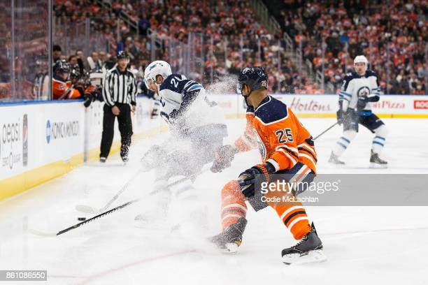 Darnell Nurse of the Edmonton Oilers pursues Blake Wheeler of the Winnipeg Jets at Rogers Place on October 9 2017 in Edmonton Canada