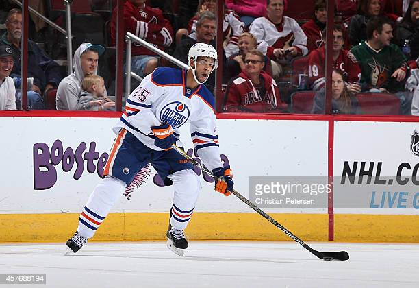 Darnell Nurse of the Edmonton Oilers skates with the puck during the NHL game against the Arizona Coyotes at Gila River Arena on October 15 2014 in...