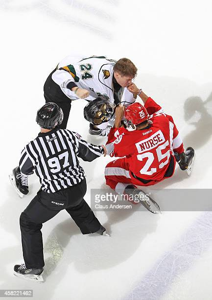 Darnell Nurse of the Sault Ste Marie Greyhounds fights Michael McCarron of the London Knights in an OHL game at Budweiser Gardens on October 31 2014...