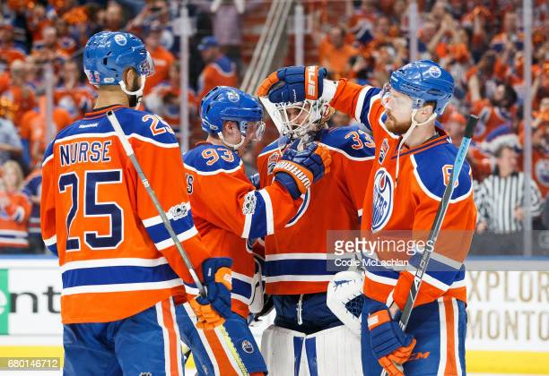 Darnell Nurse Ryan NugentHopkins and Adam Larsson of the Edmonton Oilers congratulate goalie Cam Talbot on a 71 victory against the Anaheim Ducks in...