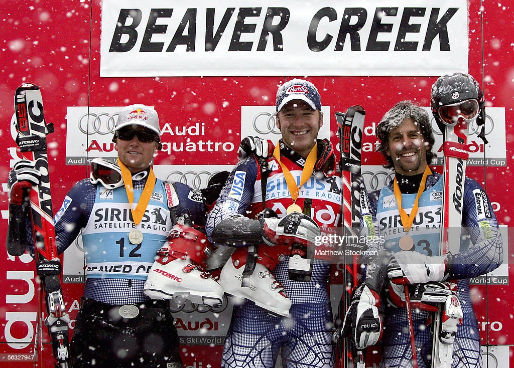 Daron Rahlves #12, Bode Miller #7 and Erik Schlopy #23 pose for photographers on the winner's podium during FIS Alpine Skiing World Cup giant slalom race on December 3, 2005 on Birds of Prey at Beaver Creek in Avon, Colorado. Rahlves placed second overall, Miller placed first overall and Schlopy placed fourth overall.