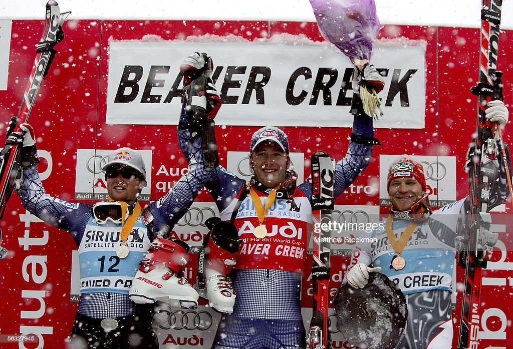 Daron Rahlves #12, Bode Miller #7 and Kalle Pallander #4 of Finland celebrate on the winner's podium during FIS Alpine Skiing World Cup giant slalom race on December 3, 2005 on Birds of Prey at Beaver Creek in Avon, Colorado. Rahlves second overall, Miller placed first and Pallander placed third overall.
