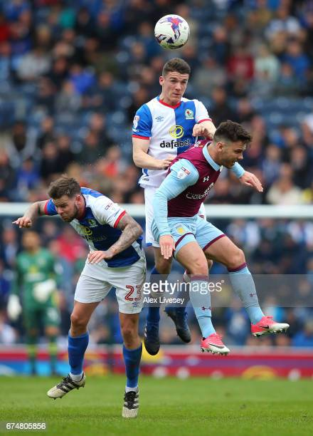 Darragh Lenihan and Danny Guthrie of Blackburn Rovers jump for a header with Scott Hogan of Aston Villa during the Sky Bet Championship match between...