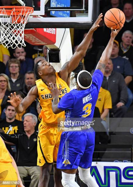 Darral Willis Jr #21 of the Wichita State Shockers blocks the shot attempt of Chris Howell of the South Dakota State Jackrabbits during the first...
