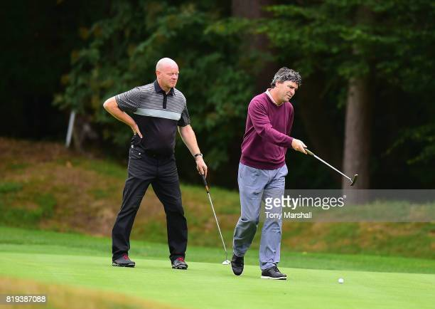 Darran Valentine and William Tebbs of Leighton Buzzard Golf Club line up a putt on the 17th green during the PGA Lombard Trophy East Qualifier at...