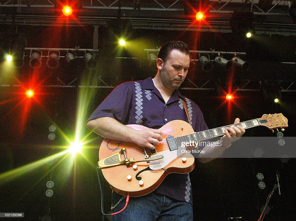 Darrel Higham performs with Imelda May at Chastain Park Amphitheater on June 11, 2010 in Atlanta, Georgia.