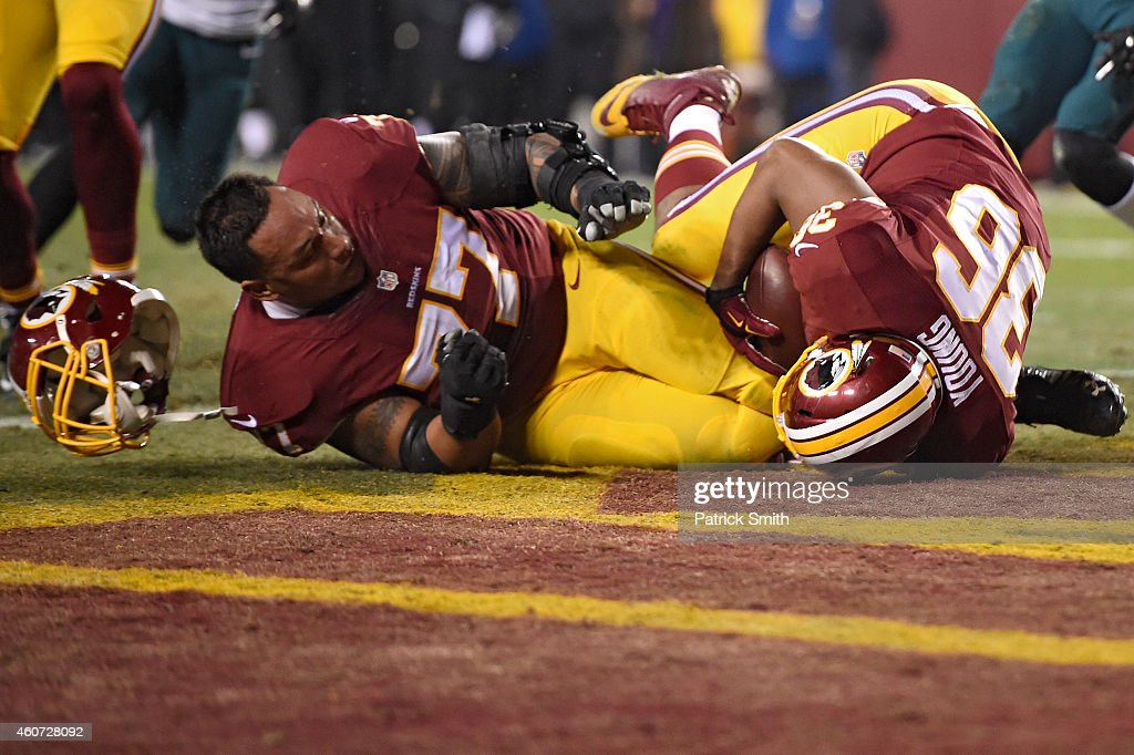 <a gi-track='captionPersonalityLinkClicked' href=/galleries/search?phrase=Darrel+Young&family=editorial&specificpeople=7410783 ng-click='$event.stopPropagation()'>Darrel Young</a> #36 of the Washington Redskins falls over <a gi-track='captionPersonalityLinkClicked' href=/galleries/search?phrase=Shawn+Lauvao&family=editorial&specificpeople=4629010 ng-click='$event.stopPropagation()'>Shawn Lauvao</a> #77 to score a touchdown in the third quarter against the Philadelphia Eagles at FedExField on December 20, 2014 in Landover, Maryland. The Washington Redskins won, 27-24.