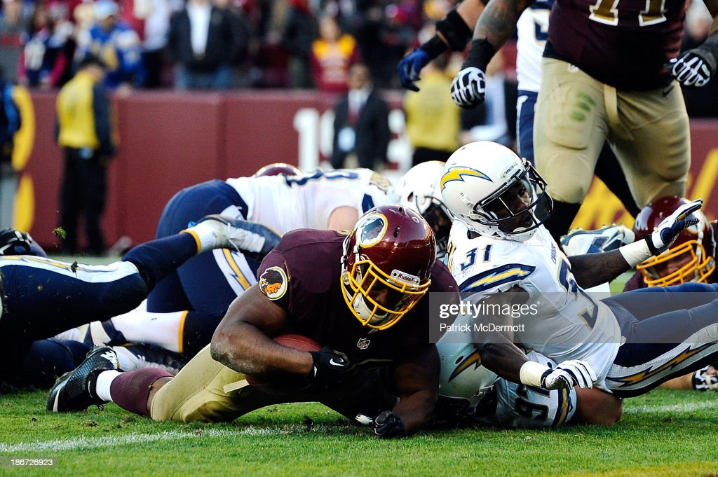 <a gi-track='captionPersonalityLinkClicked' href=/galleries/search?phrase=Darrel+Young&family=editorial&specificpeople=7410783 ng-click='$event.stopPropagation()'>Darrel Young</a> #36 of the Washington Redskins scores the game-winning touchdown in overtime against the San Diego Chargers during an NFL game at FedExField on November 3, 2013 in Landover, Maryland. The Redskins defeated the Chargers 30-24.