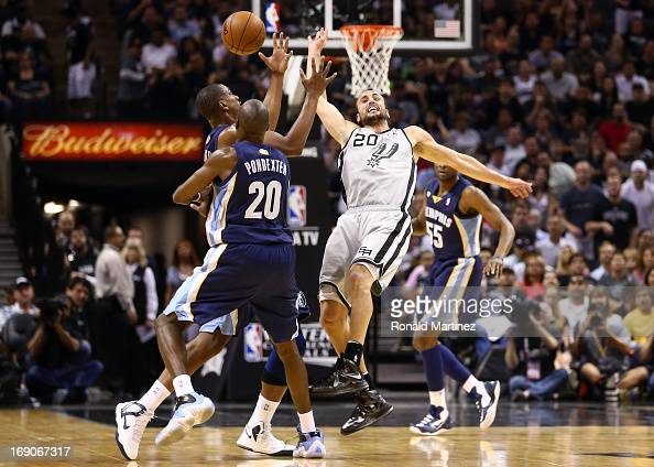 Darrell Arthur and Quincy Pondexter of the Memphis Grizzlies attempt to control the ball in the first half against Manu Ginobili of the San Antonio...