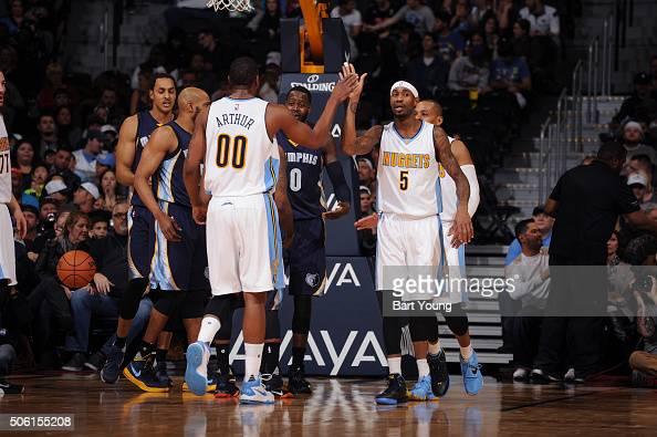 Darrell Arthur and Will Barton of the Denver Nuggets celebrate during the game against the Memphis Grizzlies on October 16 2016 at the Pepsi Center...