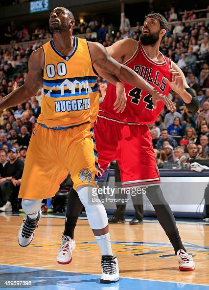 Darrell Arthur of the Denver Nuggets and Nikola Mirotic of the Chicago Bulls battle for rebounding position at Pepsi Center on November 25 2014 in...