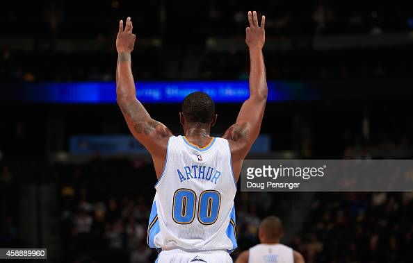 Darrell Arthur of the Denver Nuggets celebrates a teammates three point shot against the Portland Trail Blazers at Pepsi Center on November 12 2014...