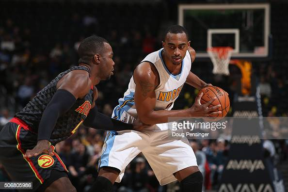 Darrell Arthur of the Denver Nuggets controls the ball against Paul Millsap of the Atlanta Hawks at Pepsi Center on January 25 2016 in Denver...