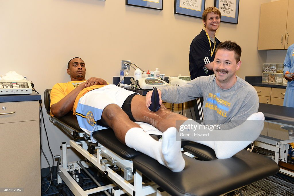 Darrell Arthur #00 of the Denver Nuggets gets checked out by a doctor after a game against the Golden State Warriors on April 16, 2014 at the Pepsi Center in Denver, Colorado.