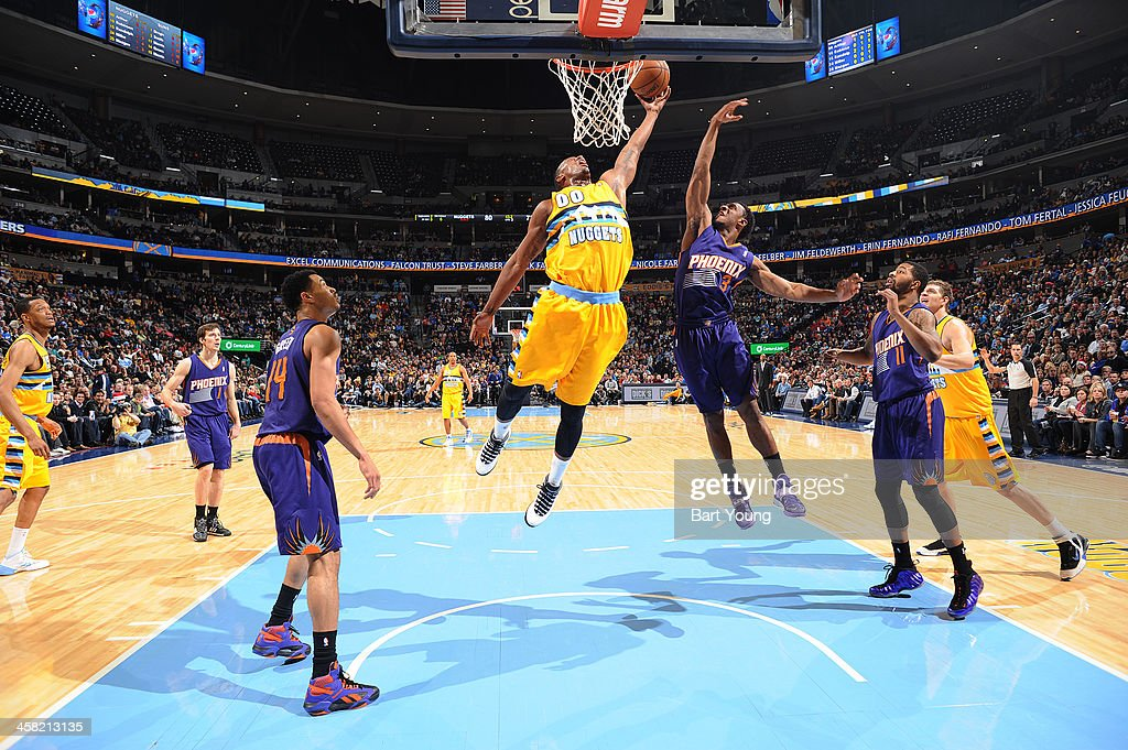 <a gi-track='captionPersonalityLinkClicked' href=/galleries/search?phrase=Darrell+Arthur&family=editorial&specificpeople=4102032 ng-click='$event.stopPropagation()'>Darrell Arthur</a> #00 of the Denver Nuggets grabs a rebound against the Denver Nuggets on December 20, 2013 at the Pepsi Center in Denver, Colorado.