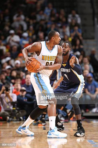 Darrell Arthur of the Denver Nuggets handles the ball against JaMychal Green of the Memphis Grizzlies on January 21 2016 at the Pepsi Center in...