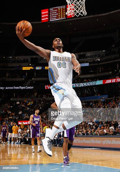 Darrell Arthur of the Denver Nuggets lays up a shot against the Sacramento Kings at Pepsi Center on November 3 2014 in Denver Colorado The Kings...