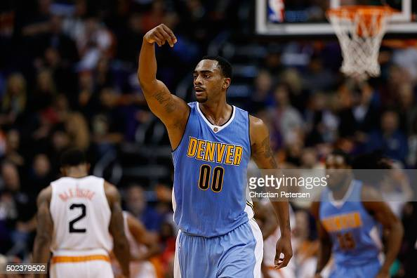 Darrell Arthur of the Denver Nuggets reacts to a three point shot against the Phoenix Suns during the second half of the NBA game at Talking Stick...