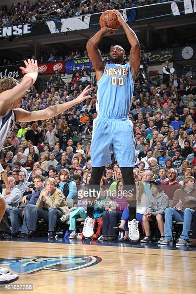 Darrell Arthur of the Denver Nuggets shoots against the Dallas Mavericks on January 16 2015 at the American Airlines Center in Dallas Texas NOTE TO...