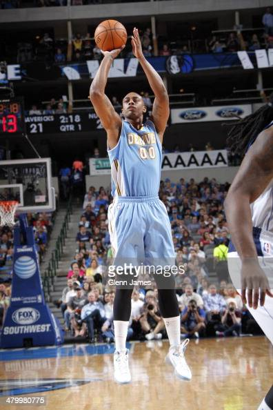 Darrell Arthur of the Denver Nuggets shoots against the Dallas Mavericks on March 21 2014 at the American Airlines Center in Dallas Texas NOTE TO...