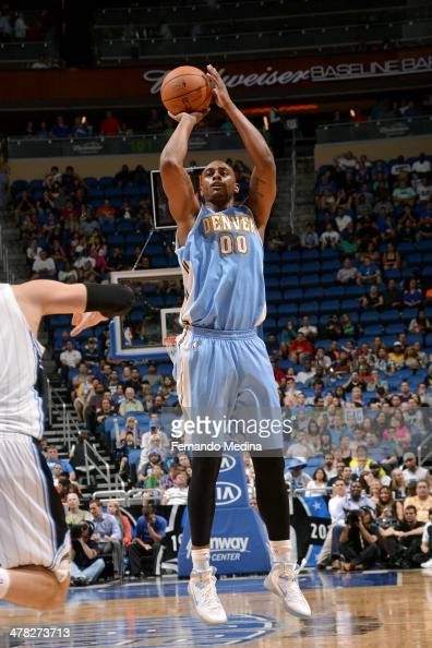 Darrell Arthur of the Denver Nuggets shoots against the Orlando Magic on March 12 2014 at Amway Center in Orlando Florida NOTE TO USER User expressly...
