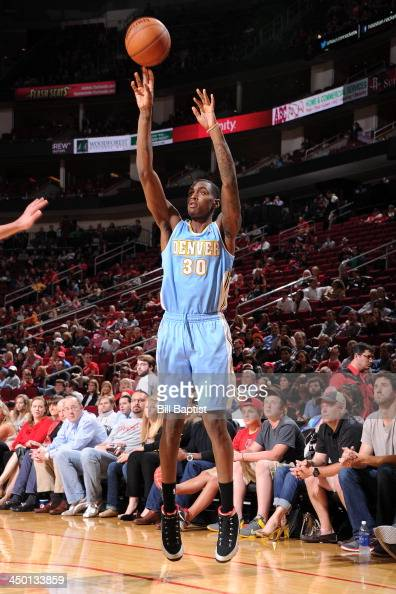 Darrell Arthur of the Denver Nuggets shoots the ball against the Houston Rockets on November 16 2013 at the Toyota Center in Houston Texas NOTE TO...