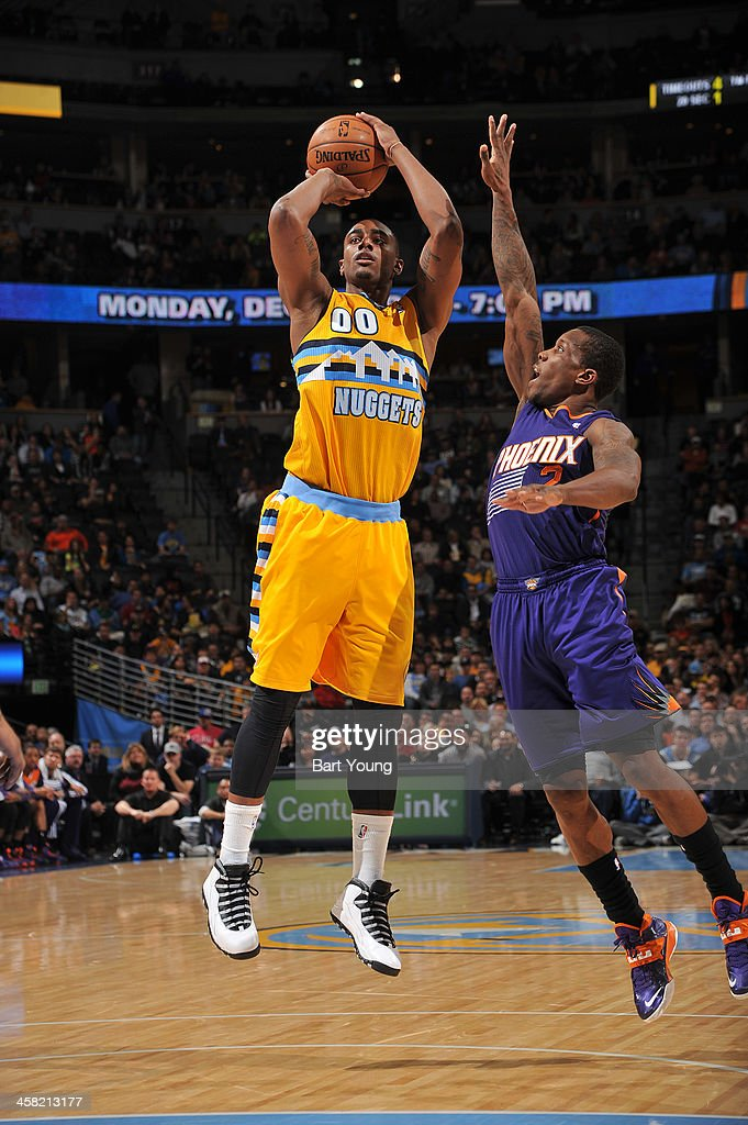 <a gi-track='captionPersonalityLinkClicked' href=/galleries/search?phrase=Darrell+Arthur&family=editorial&specificpeople=4102032 ng-click='$event.stopPropagation()'>Darrell Arthur</a> #00 of the Denver Nuggets shoots the ball against the Phoenix Suns on December 20, 2013 at the Pepsi Center in Denver, Colorado.