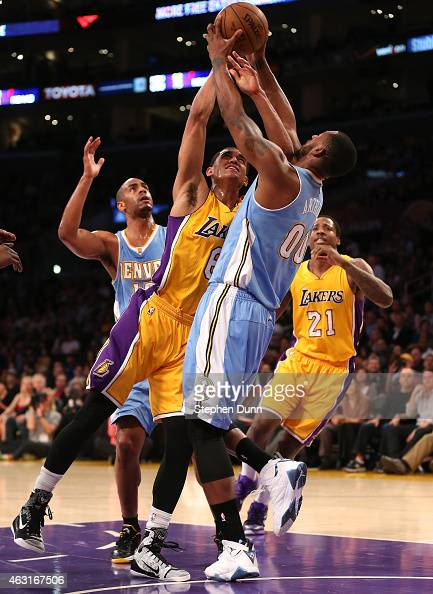 Darrell Arthur of the Denver Nuggets takes the ball away from Jordan Clarkson of the Los Angeles Lakers at Staples Center on February 10 2015 in Los...