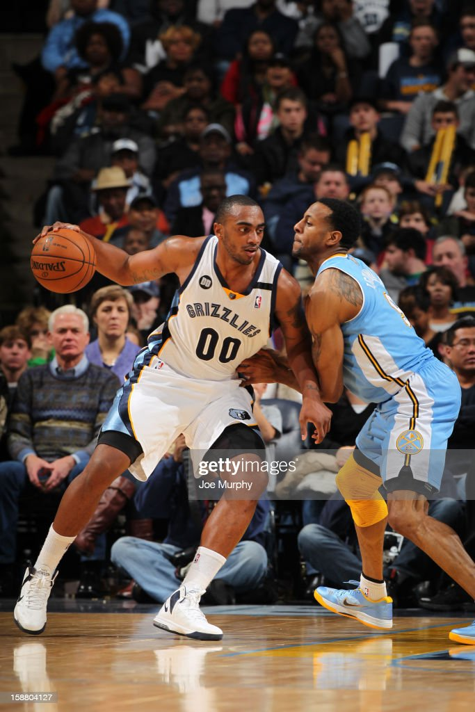 <a gi-track='captionPersonalityLinkClicked' href=/galleries/search?phrase=Darrell+Arthur&family=editorial&specificpeople=4102032 ng-click='$event.stopPropagation()'>Darrell Arthur</a> #00 of the Memphis Grizzlies drives against <a gi-track='captionPersonalityLinkClicked' href=/galleries/search?phrase=Andre+Iguodala&family=editorial&specificpeople=201980 ng-click='$event.stopPropagation()'>Andre Iguodala</a> #9 of the Denver Nuggets on December 29, 2012 at FedExForum in Memphis, Tennessee.