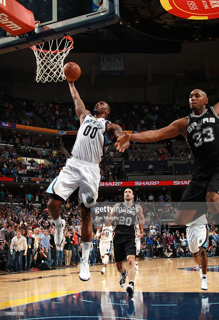 Darrell Arthur #00 of the Memphis Grizzlies dunks against Boris Diaw #33 of the San Antonio Spurs on January 11, 2013 at FedExForum in Memphis, Tennessee.