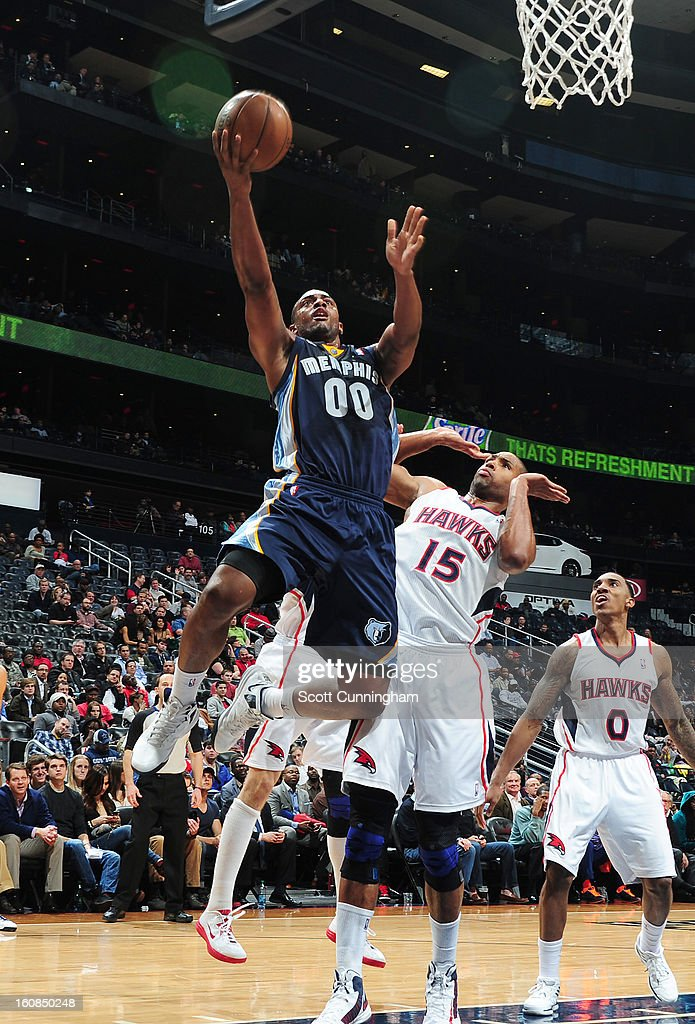 Darrell Arthur #00 of the Memphis Grizzlies goes to the basket against Al Horford #15 of the Atlanta Hawks during the game between the Atlanta Hawks and the Memphis Grizzlies on February 6, 2013 at Philips Arena in Atlanta, Georgia.