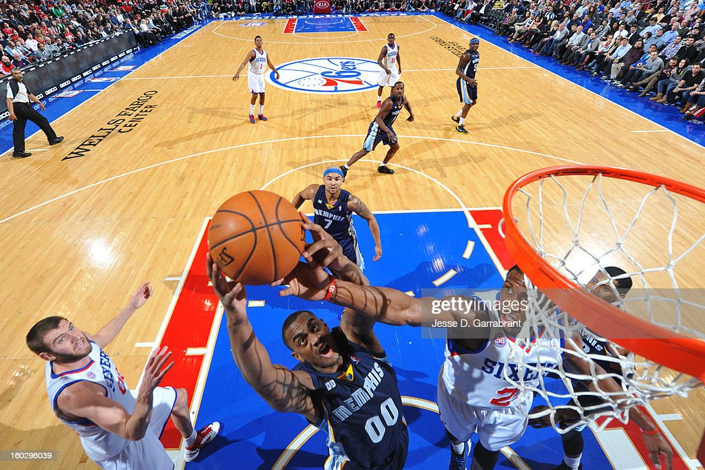 Darrell Arthur #00 of the Memphis Grizzlies goes up for a rebound against Thaddeus Young #21 of the Philadelphia 76ers during the game at the Wells Fargo Center on January 28, 2013 in Philadelphia, Pennsylvania.
