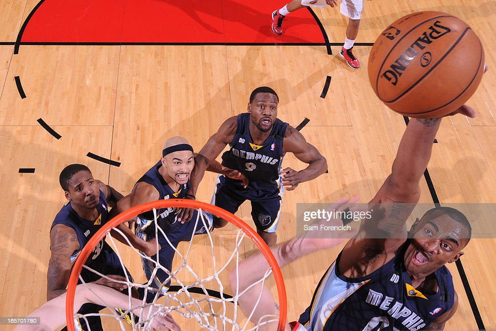<a gi-track='captionPersonalityLinkClicked' href=/galleries/search?phrase=Darrell+Arthur&family=editorial&specificpeople=4102032 ng-click='$event.stopPropagation()'>Darrell Arthur</a> #00 of the Memphis Grizzlies grabs a rebound against the Portland Trail Blazers on April 3, 2013 at the Rose Garden Arena in Portland, Oregon.