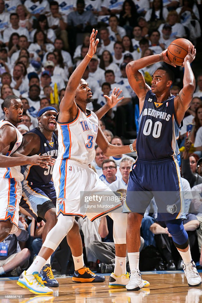 Darrell Arthur #00 of the Memphis Grizzlies looks to pass the ball against Kevin Durant #35 of the Oklahoma City Thunder in Game Five of the Western Conference Semifinals during the 2013 NBA Playoffs on May 15, 2013 at the Chesapeake Energy Arena in Oklahoma City, Oklahoma.