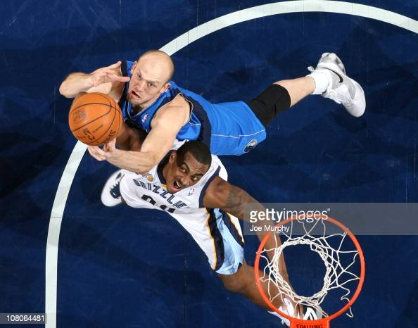 Darrell Arthur of the Memphis Grizzlies rebounds against Brian Cardinal of the Dallas Mavericks on January 15 2011 at FedExForum in Memphis Tennessee...