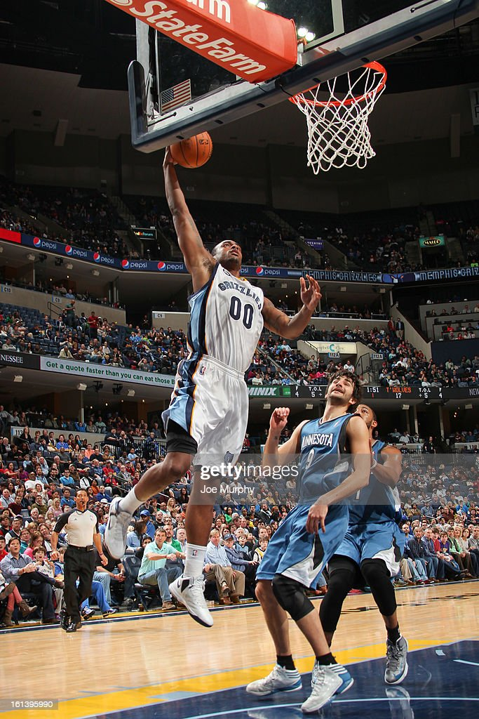 Darrell Arthur #00 of the Memphis Grizzlies rises for a dunk against Ricky Rubio #9 of the Minnesota Timberwolves on February 10, 2013 at FedExForum in Memphis, Tennessee.