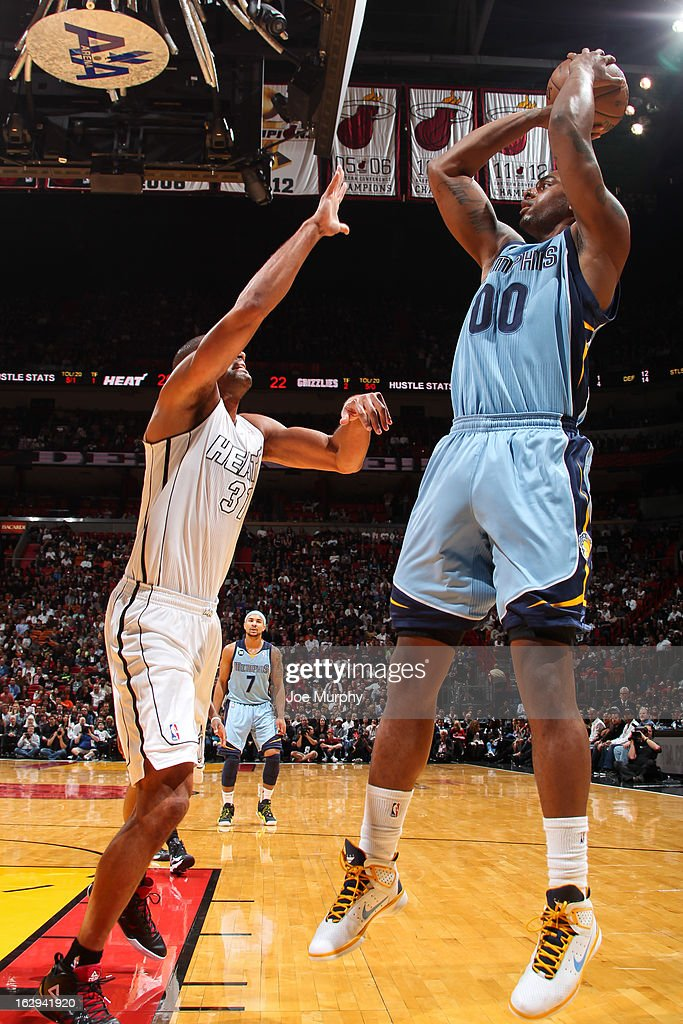 Darrell Arthur #00 of the Memphis Grizzlies shoots against Shane Battier #31 of the Miami Heat on March 1, 2013 at American Airlines Arena in Miami, Florida.