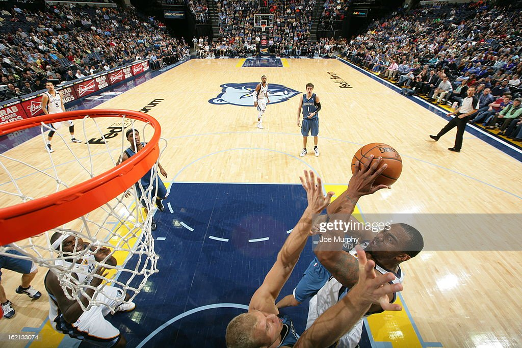 <a gi-track='captionPersonalityLinkClicked' href=/galleries/search?phrase=Darrell+Arthur&family=editorial&specificpeople=4102032 ng-click='$event.stopPropagation()'>Darrell Arthur</a> #00 of the Memphis Grizzlies shoots against the Minnesota Timberwolves on February 10, 2013 at FedExForum in Memphis, Tennessee.