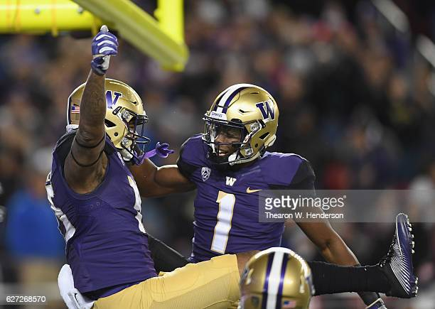 Darrell Daniels of the Washington Huskies celebrates with John Ross after Daniels scored a touchdown against the Colorado Buffaloes during the Pac12...