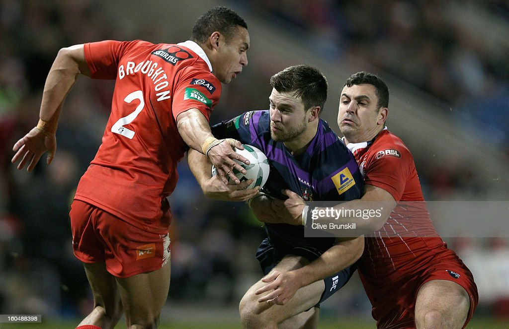 Darrell Goulding of Wigan Warriors attempts to move past Jodie Broughton of Salford City Reds during the Super League match between Salford City Reds and Wigan Warriors at Salford City Stadium on February 1, 2013 in Salford, England.