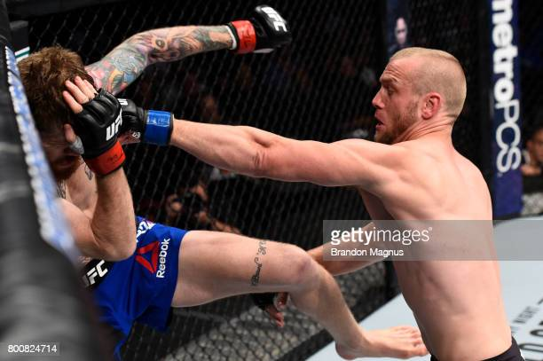 Darrell Horcher punches Devin Powell in their lightweight bout during the UFC Fight Night event at the Chesapeake Energy Arena on June 25 2017 in...