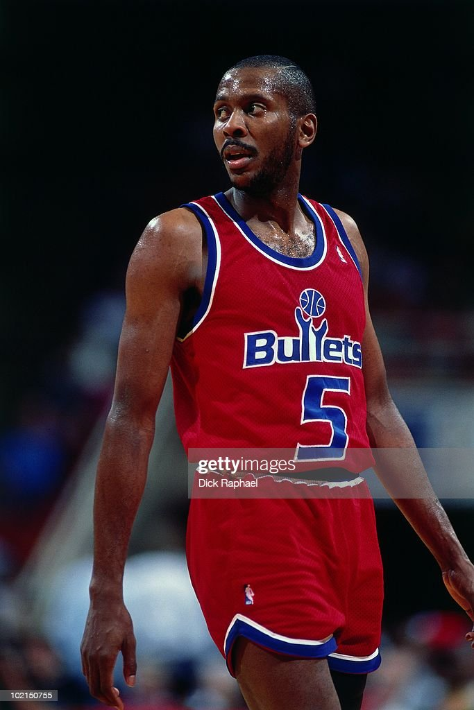 Darrell Walker #5 of the Washington Bullets stands against the Houston Rockets during a game played in 1990 at the Summitt in Houston, Texas.