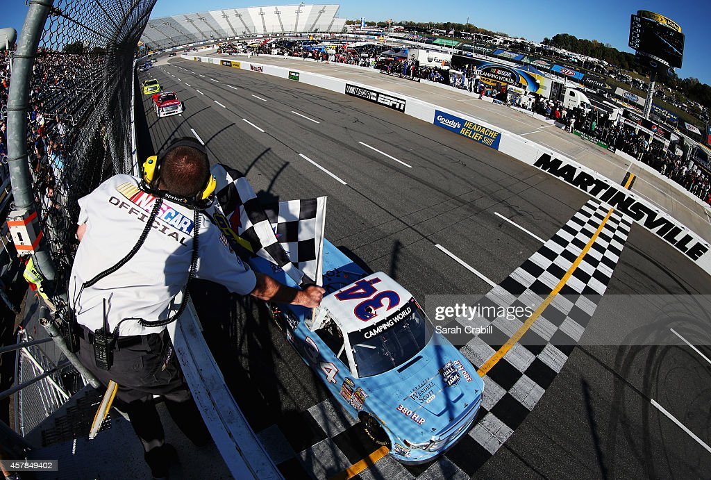 Darrell Wallace, Jr., driver of the #34 2015 NASCAR Hall of Fame Inductee Wendell Scott Toyota, takes the checkered flag to win the NASCAR Camping World Truck Series Kroger 200 at Martinsville Speedway on October 25, 2014 in Martinsville, Virginia.