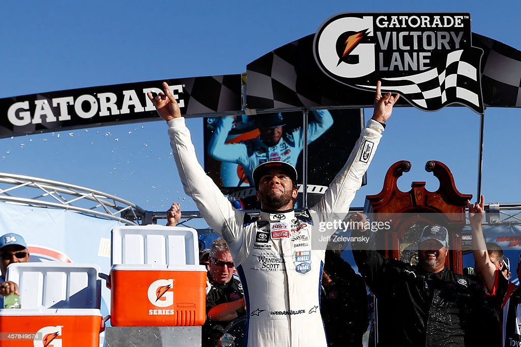 Darrell Wallace, Jr., driver of the #34 2015 NASCAR Hall of Fame Inductee Wendell Scott Toyota, celebrates in Victory Lane after winning the NASCAR Camping World Truck Series Kroger 200 at Martinsville Speedway on October 25, 2014 in Martinsville, Virginia.