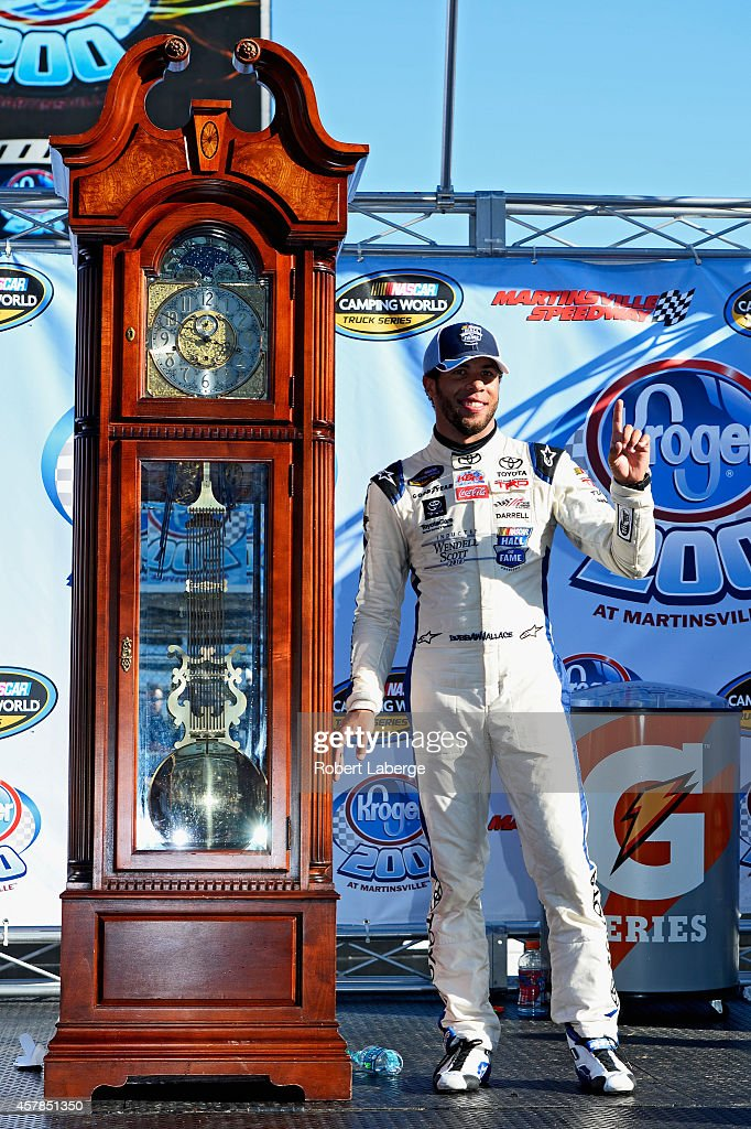 Darrell Wallace, Jr., driver of the #34 2015 NASCAR Hall of Fame Inductee Wendell Scott Toyota, poses with the winners in Victory Lane after winning the NASCAR Camping World Truck Series Kroger 200 at Martinsville Speedway on October 25, 2014 in Martinsville, Virginia.